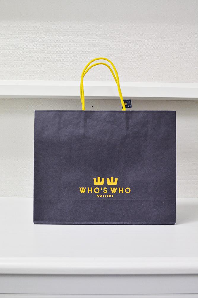 紺色と黄色のお洒落な紙袋