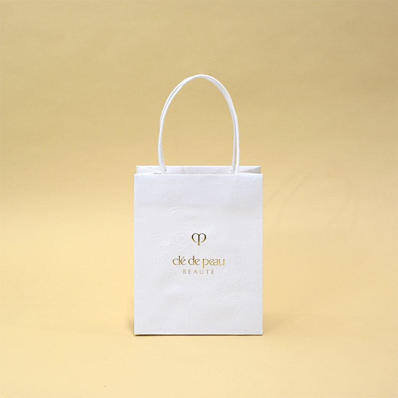 オリエンタルな花柄と差し色で高級感な紙袋