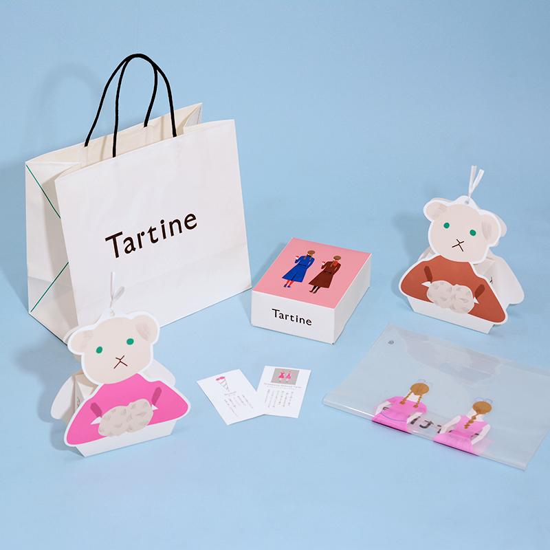 愛らしピンクと双子モチーフで大人キュートな紙袋