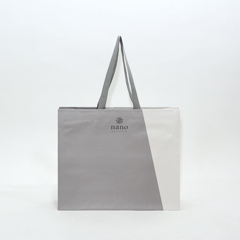 大胆な切り替えデザインの大きめ肩掛け紙袋