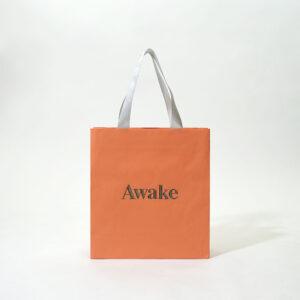 シルバーとオレンジのシンプルな紙袋